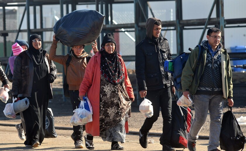 Migrants and refugees carrying their belongings arrive at a transit camp in Slavonski Brod, Croatia on Nov. 4. Bernie Sanders, among others, has made statements linking climate change to terrorism.