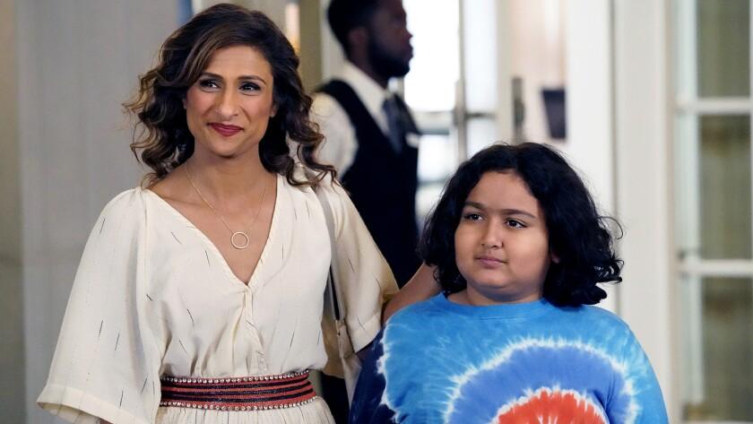 "Sarayu Blue and Rahm Braslaw in ""I Feel Bad"" on NBC."