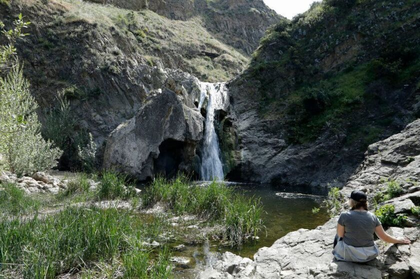 Kirstin Keagy of Ventura enjoys the view of Paradise Falls at Wildwood Regional Park in Thousand Oaks.