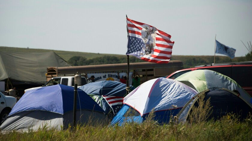 Tents and a flag are seen at an oil pipeline protest encampment near Cannon Ball, N.D., on Sept. 3, 2016.