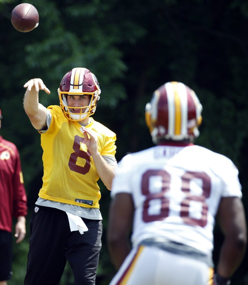 Washington Redskins quarterback Kirk Cousins (8) throws a pass to wide receiver Pierre Garcon (88) during practice at the team's NFL football training facility at Redskins Park, Wednesday, June 1, 2016 in Ashburn, Va. (AP Photo/Alex Brandon)