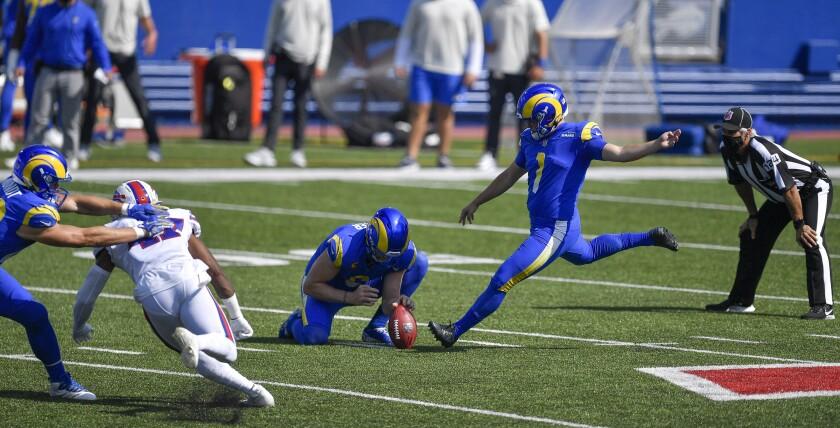 Johnny Hekker holds for Rams placekicker Samuel Sloman against Buffalo in Week 3.