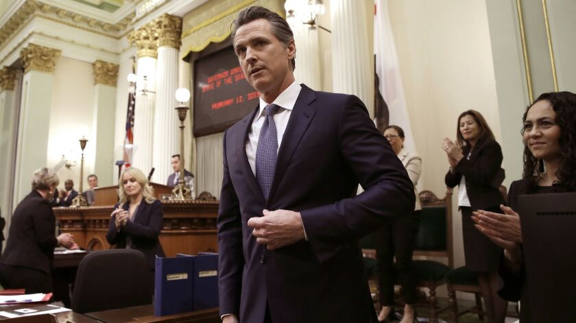 California Gov. Gavin Newsom receives applause after delivering his first State of the State address to a joint session of the Legislature at the Capitol in Sacramento.