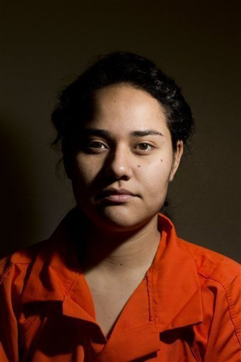 Maria Peniche, 22, poses for a portrait inside the Eloy Detention Center in Eloy, Arizona, Monday, Aug. 5, 2013. The Homeland Security Department took the highly unusual step of tentatively approved asylum requests for nine Mexican immigrants, including Peniche, who left the U.S. and attempted to re-enter as part of a protest against U.S. deportation policies. An immigration judge will have the final say whether they can remain permanently in the United States, but such a ruling could take years