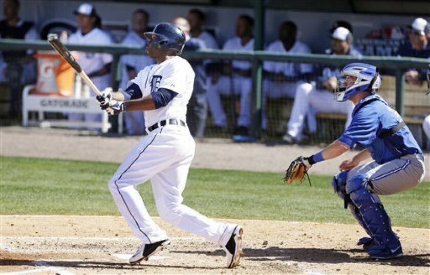 Detroit Tigers' Torii Hunter watches his fifth inning home run in front of Toronto Blue Jays catcher Josh Thole, right, during a baseball spring training exhibition game, Wednesday, March 6, 2013, in Lakeland, Fla. (AP Photo/Charlie Neibergall)
