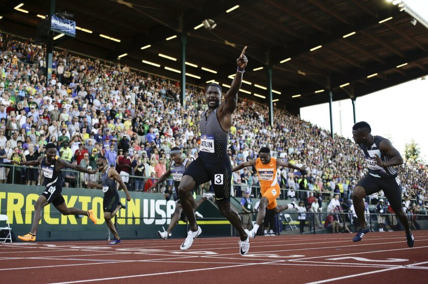 FILE - In this July 3, 2016, file photo, Justin Gatlin reacts after winning the during for men's 100-meter final at the U.S. Olympic Track and Field Trials in Eugene Ore. Gatlin will be competing at the Rio Games. (AP Photo/Matt Slocum)