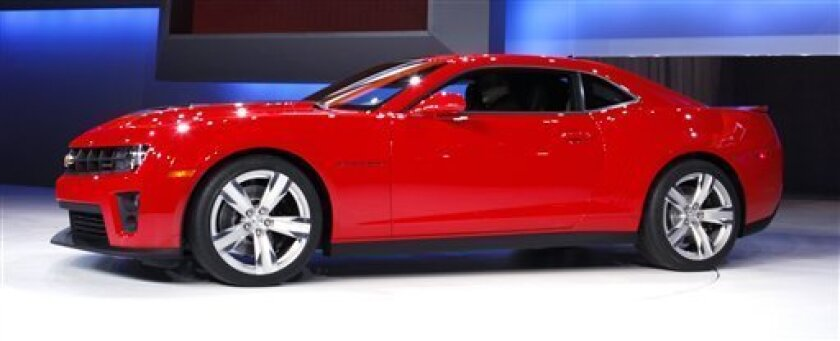 In this Feb. 9, 2011 photo, a 2012 Chevrolet Camaro ZL1 is displayed at the Chicago Auto Show, in Chicago. Falling gas prices brought people back to General Motors showrooms in June, 2011, with the company reporting a 10 percent increase from a year earlier. (AP Photo/Charles Rex Arbogast)