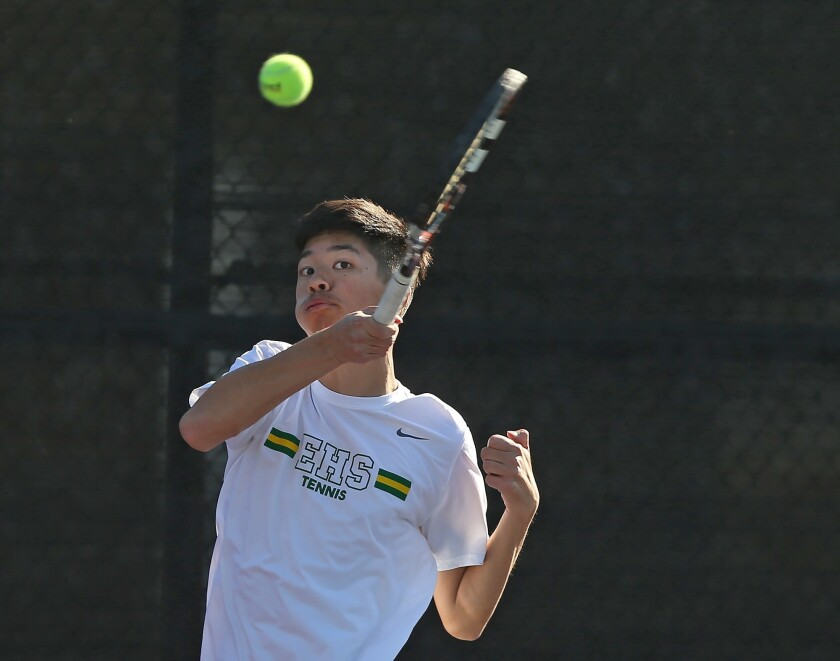 Edison number one doubles player Ryan Lum hits a return during Wave League tennis match against Lagu