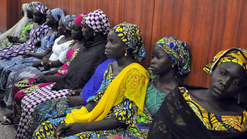 Schoolgirls from the Nigerian village of Chibok who escaped from Boko Haram kidnappers wait to talk with the governor of Borno state in Maiduguri in June.