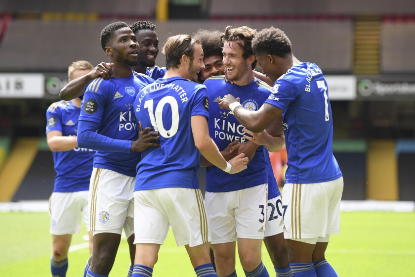 Leicester's Ben Chilwell, center right, celebrates after scoring his side's opening goal during the English Premier League soccer match between Watford and Leicester City at the Vicarage Road Stadium in Watford, England, Saturday, June 20, 2020. (Andy Rain/Pool via AP)