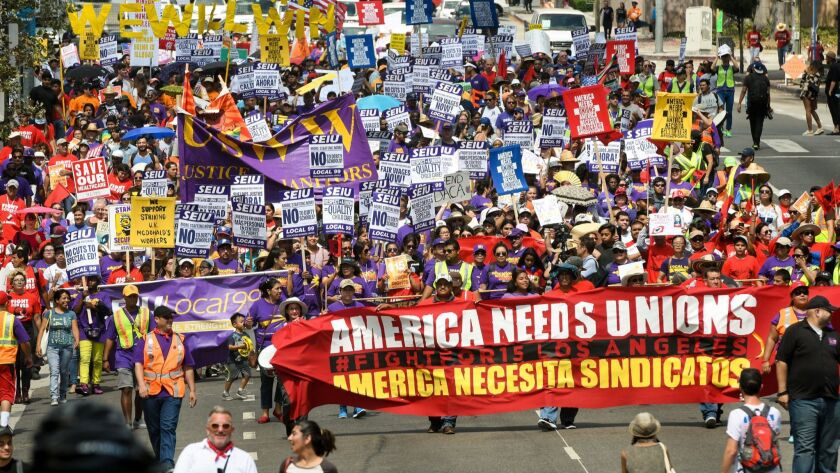 LOS ANGELES, CA - SEPTEMBER 4, 2017: Demonstrators march through downtown Los Angeles during a Labor