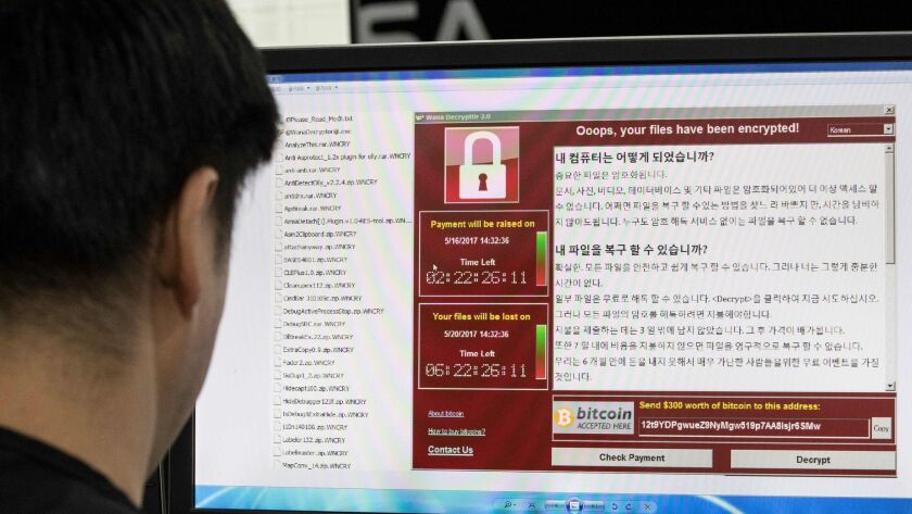 Staff monitoring the spread of ransomware cyber-attacks at the Korea Internet and Security Agency (K