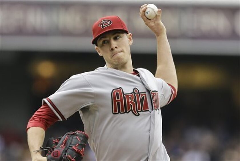 Arizona Diamondbacks starting pitcher Patrick Corbin pitches against the San Diego Padres in the first inning of a baseball game in San Diego, Saturday, May 4, 2013. (AP photo/Lenny Ignelzi)