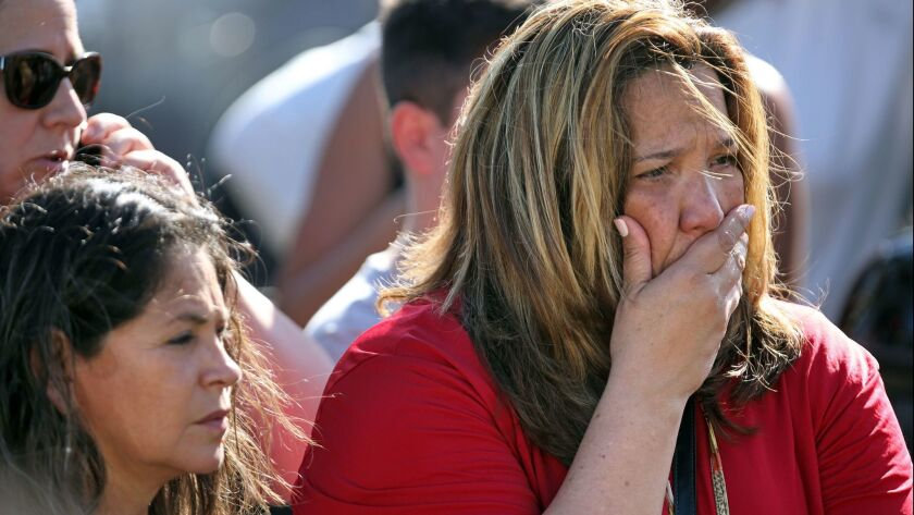 Waiting for word from students just south of the campus of Stoneman Douglas High School in Parkland, Fla., after a deadly shooting Wednesday.