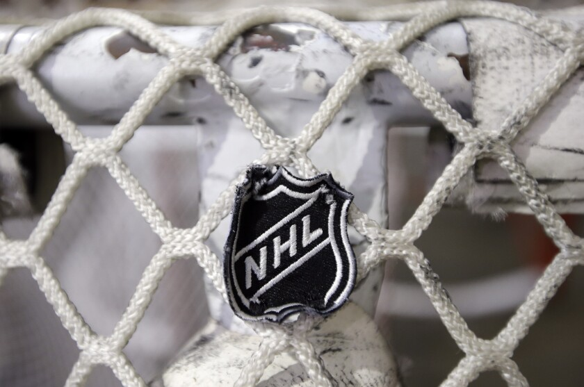 The NHL logo is seen on a goal at a Predators practice rink in Nashville, Tenn.
