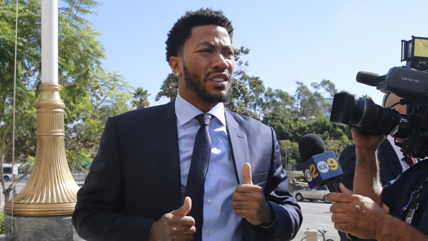 New York Knicks basketball player Derrick Rose arrives at U.S. District Court in downtown Los Angeles during the civil trial in which a former girlfriend accused him and two friends of raping her.