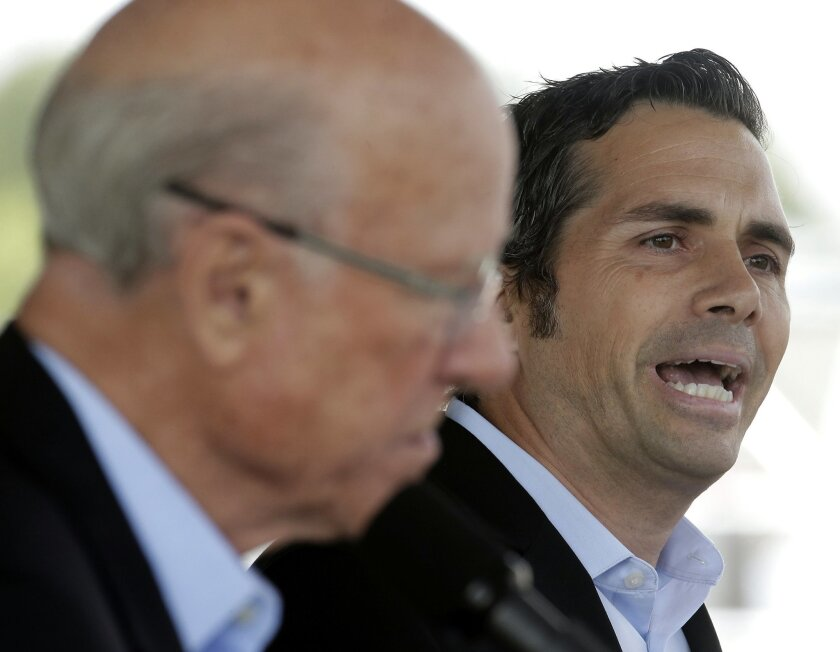 Republican Sen. Pat Roberts, left, listens while independent candidate Greg Orman answers a question during a debate at the Kansas State Fair Saturday, Sept. 6, 2014, in Hutchinson, Kan. (AP Photo/Charlie Riedel)