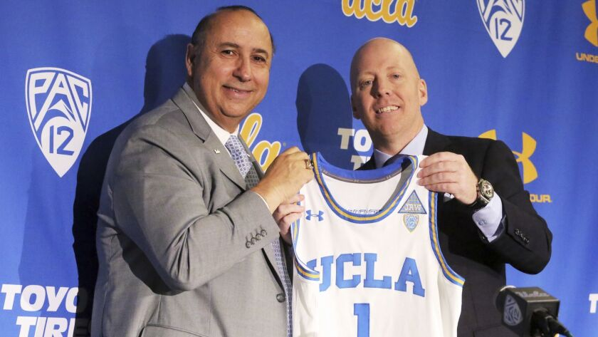Mick Cronin, right, and athletic director Dan Guerrero pose as Cronin is introduced as UCLA's new he