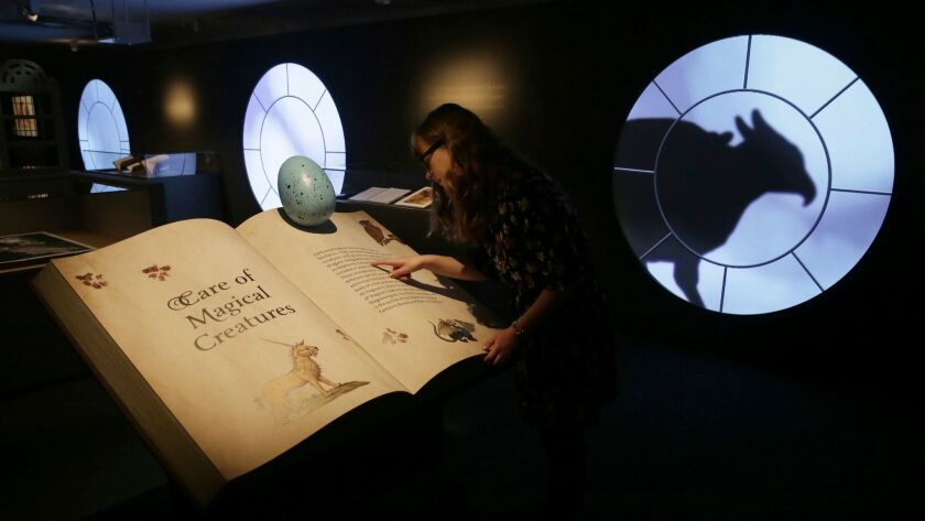 "A staff member checks out the ""Harry Potter: A History of Magic"" exhibition at the British Library in London."