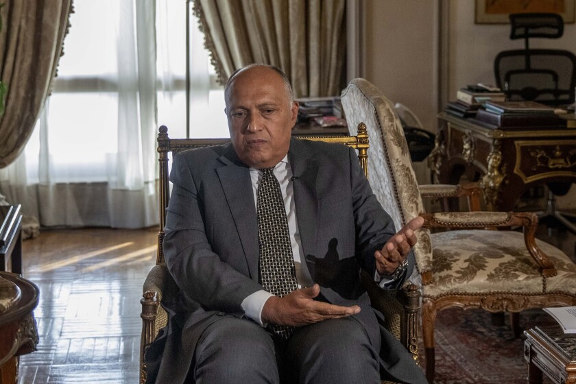 FILE - In this June 21, 2020, file photo, Egypt's Foreign Minister Sameh Shukry speaks during an interview with The Associated Press at his office in Cairo, Egypt. Shukry said Wednesday, July 7, 2021, he will urge the U.N. Security Council to require Egypt, Sudan and Ethiopia to negotiate a binding agreement within six months on the contentious issue of water availability from the dam that the Ethiopians are building on the main tributary of the Nile River. (AP Photo/Nariman El-Mofty, File)