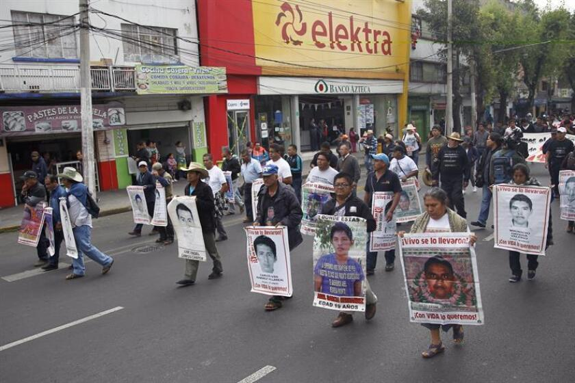 Family members of the 43 students of the Ayotzinapa teacher training school, who disappeared on September 26, 2014, make a pilgrimage to the Basilica of Guadalupe, in Mexico City, on 26 December 2018. EFE-EPA/Sashenka Gutierrez
