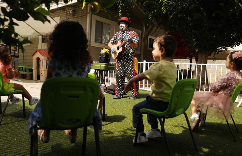 Guilford Adams performs a show for children at a preschool in Glendale on June 1.