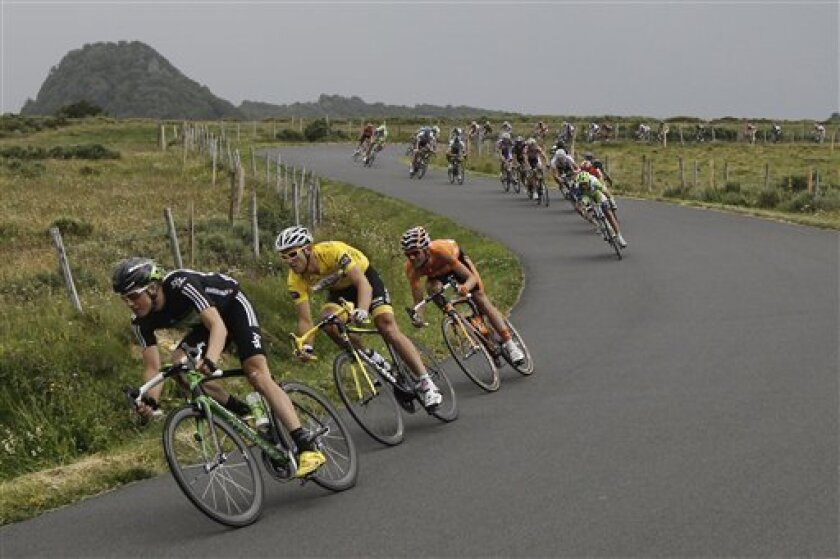 Thor Hushovd of Norway, wearing the overall leader's yellow jersey, follows Edvald Boasson Hagen of Norway, left, as they speed down La Croix Saint Robert Pass during the 8th stage of the Tour de France cycling race over 189 kilometers (117.5 miles) starting in Aigurande  and finishing in Super Bes