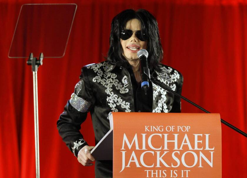 "Michael Jackson, shown in March 2009, announces his 50-show ""This Is It"" comeback concerts set for July of that year at London's O2 Arena. His mother and children have filed a wrongful-death suit against concert promoter AEG Live."