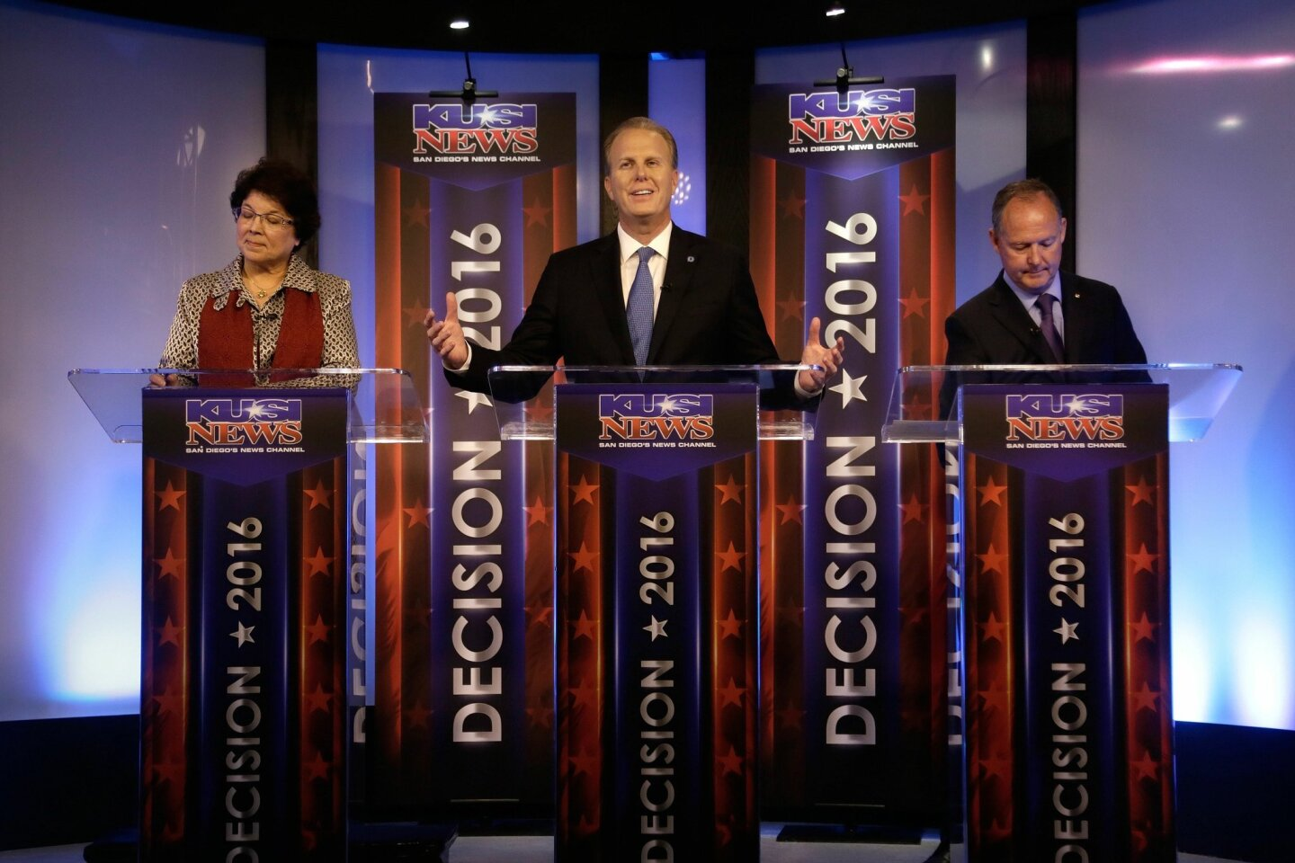 From left to right, San Diego Mayoral candidates Lori Saldaña, Kevin Faulconer, and Ed Harris participate in a mayoral debate on KUSI Tuesday night.
