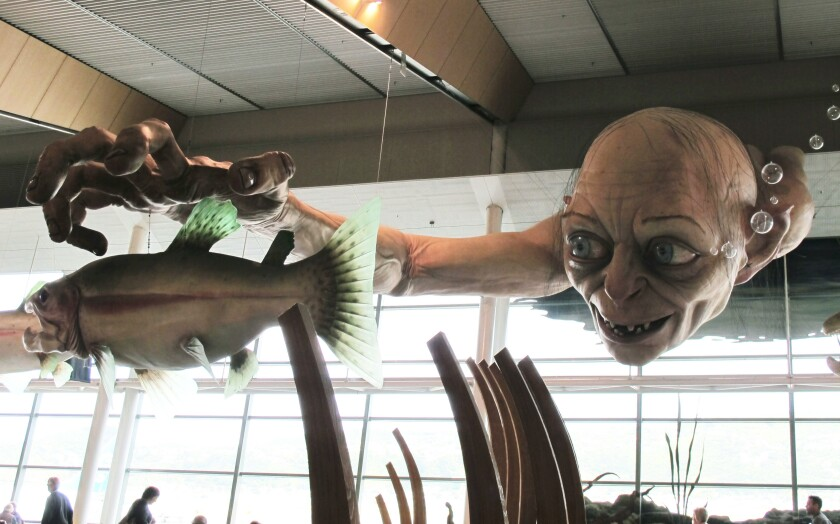 """FILE - In this Nov. 24, 2012, file photo, a giant sculpture of Gollum, a character from """"The Hobbit,"""" is displayed in the Wellington Airport. Amazon announced Wednesday, Sept. 18, 2019, it will film its upcoming television series """"The Lord of the Rings"""" in New Zealand, marking a return of the orcs, elves and hobbits to the country they became synonymous with over the course of six movies directed by Peter Jackson. (AP Photo/Nick Perry,File)"""
