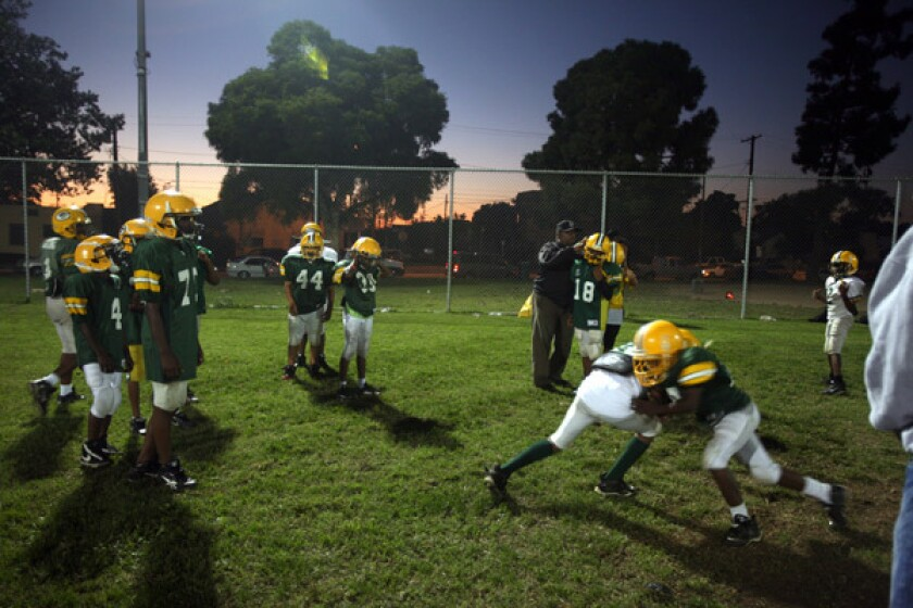 The South Park Demos go through football drills in preparation for a Saturday matchup against rival Compton. The Demos football program was brought to South Park by Parie Dedeaux, better known as Blue. More photos >>>