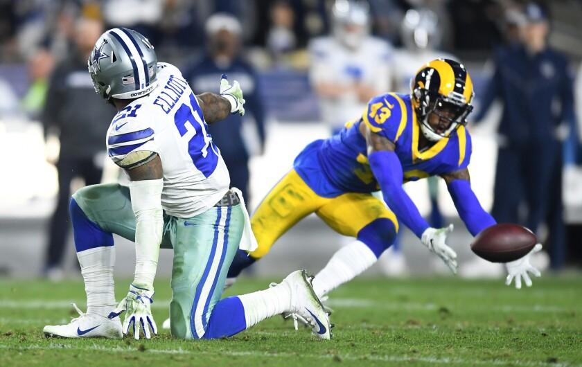 Rams safety John Johnson almost intercepts a pass as Cowboys running back Ezekiel Elliott watches.