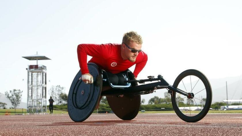 SAN DIEGO_|Wheelchair Parlaympian Austin Pruitt takes out his wheelchair on the track at the Olympic Training Center in Chula Vista.|John Gastaldo/San Diego Union-Tribune (San Diego Union-Tribune)