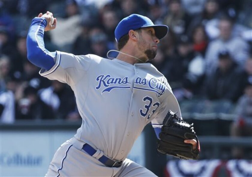 Kansas City Royals starting pitcher James Shields (33) delivers a pitch against the Chicago White Sox during their season opening baseball game Monday, April 1, 2013, in Chicago. (AP Photo/Charles Rex Arbogast)
