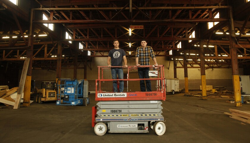 Brouwerij West's Brian Mercer and Dave Holop inside Warehouse No. 9, which is being turned into a brewery and restaurant.