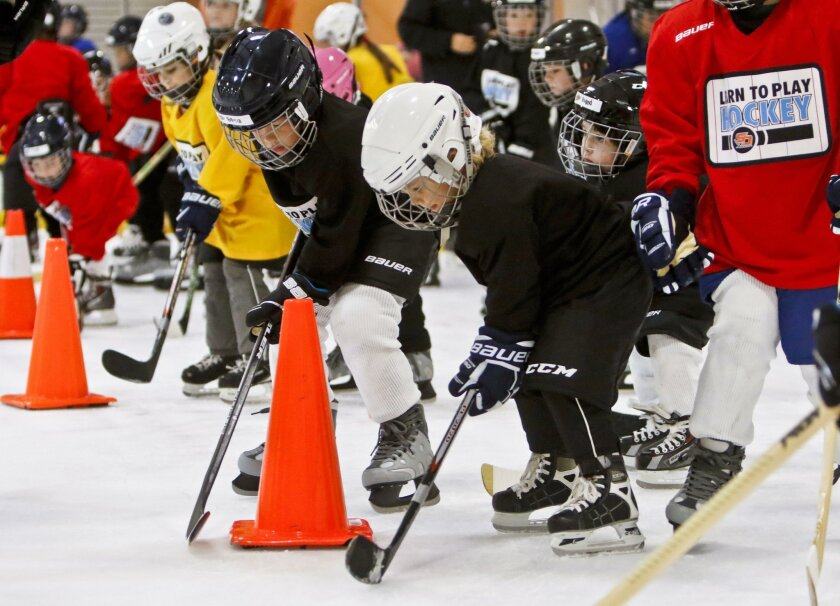"""About 30 ice skaters get set to run drills while taking part in the San Diego Gulls' """"Learn to Play Hockey"""" event at the Poway Ice Arena recently."""