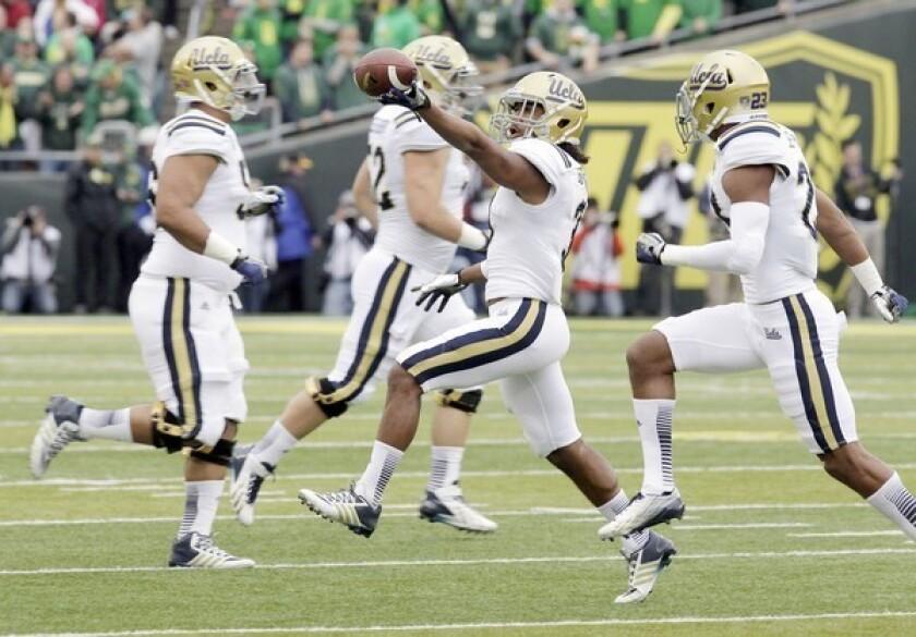UCLA's Randall Goforth runs off the field with the ball after recovering an Oregon fumble caused by linebacker Myles Jack on the second play of the game at Autzen Stadium on Saturday.