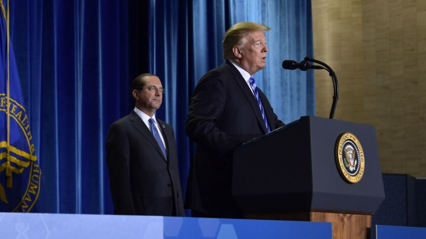President Trump, right, with Health and Human Services Secretary Alex Azar at a presentation on drug prices in 2018.