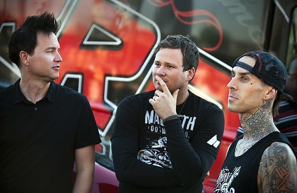 Blink-182 members bassist-vocalist Mark Hoppus, left, guitarist-vocalist Tom DeLonge and drummer Travis Barker participate in a promotional contest before their concert at the Honda Center in Anaheim.