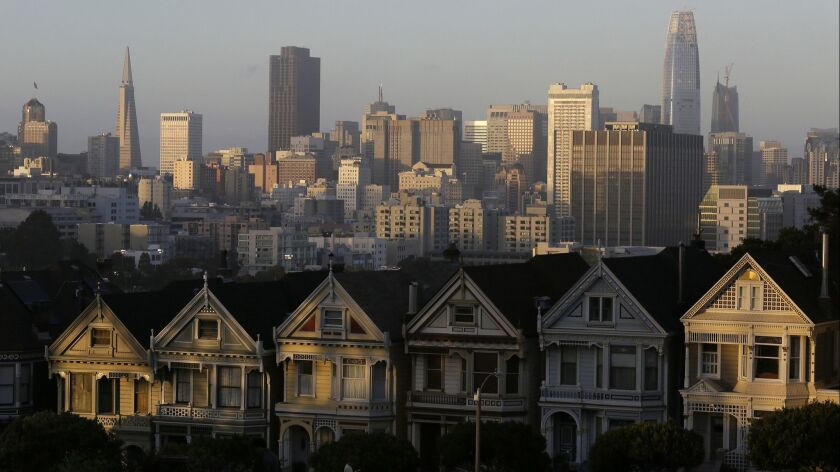 FILE - This July 11, 2017, file photo, shows the skyline beyond a row of Victorian houses in San Fra