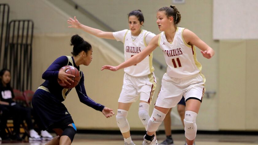 Mater Dei's Marissa Sanchez is guarded by Mission Hills' Susie Reynoso (left) and Amber Schmidt, at right.