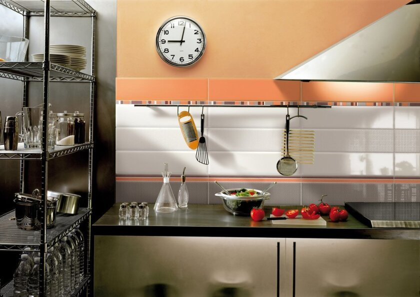 A backsplash, like this one featuring CIR's Flair tiles from Italy, can add color to your kitchen sensibly and stylishly.