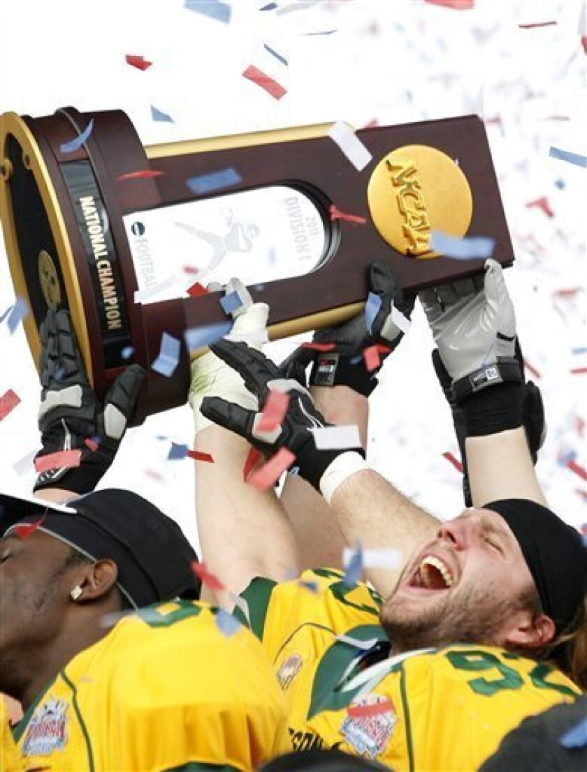 North Dakota State defensive end Coulter Boyer (92) celebrate with teammates after defeating Sam Houston State 17-6 in the FCS championship NCAA college football game, Saturday, Jan. 7, 2012, in Frisco, Texas. (AP Photo/LM Otero)