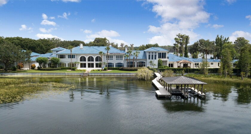 The 31,000-square-foot home includes 12 bedrooms, 15 bathrooms and a 6,000-square-foot indoor basketball court.