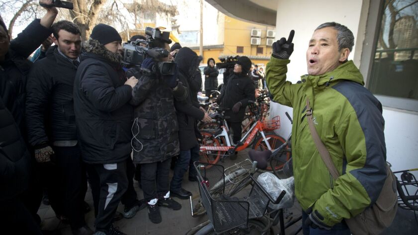 A supporter of Chinese human rights lawyer Wang Quanzhang speaks near the Secondary Intermediate People's Court of Tianjin in Tianjin, China, on Dec. 26.