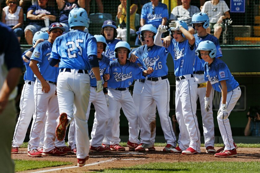 Bonita, Calif.'s Dante Schmid (25) is greeted by teammates after hitting a three-run home run off Bowling Green, Ky.'s Eli Burwash during the third inning of a baseball game in United States pool play at the Little League World Series tournament in South Williamsport, Pa., Friday, Aug. 21, 2015. (AP Photo/Gene J. Puskar)