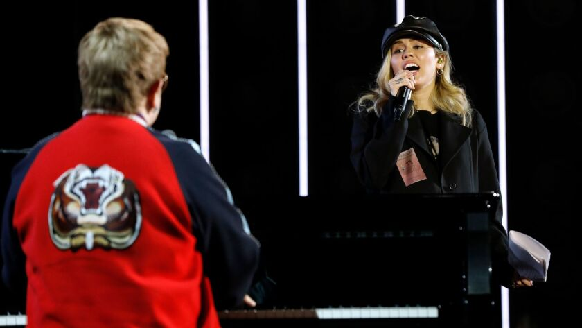 NEW YORK, NEW YORK--JAN. 25, 2018--Elton John rehearses with Miley Cyrus for the 60th Annual Grammy
