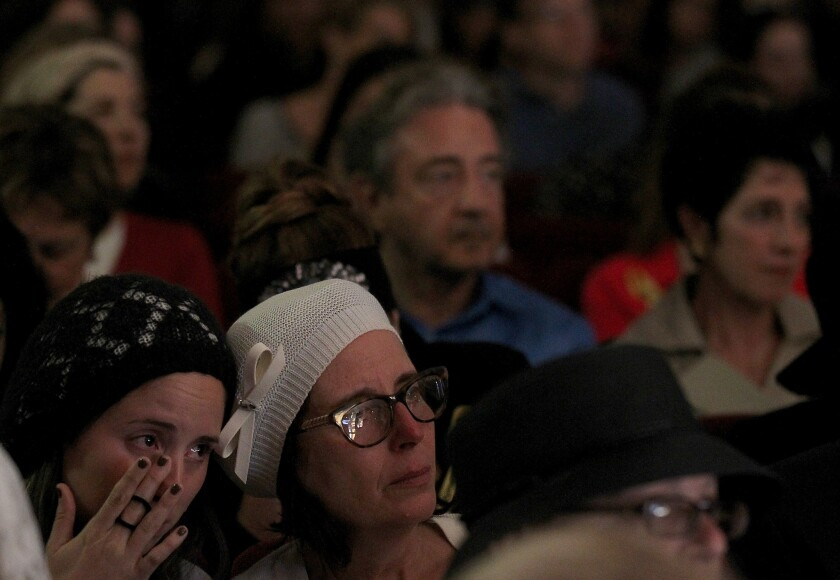 A mourner sheds tears for three slain Israeli teens at a memorial service Tuesday night in Beverly Hills.