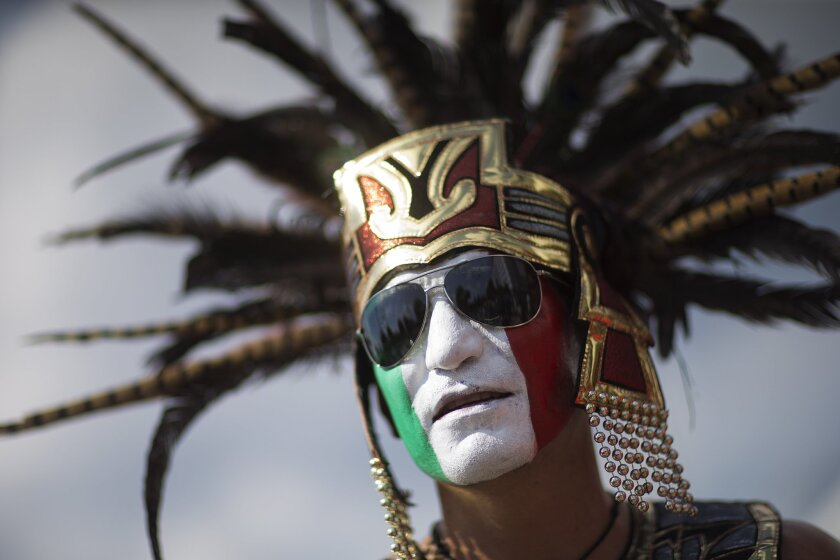 Luis Angel, of Jackson, Miss., is dressed up as an Aztec Indian before the start of the CONCACAF Gold Cup semifinal playoff soccer games featuring Jamaica against the United States and Mexico against Panama Wednesday, July 22, 2015, in Atlanta. (AP Photo/David Goldman)