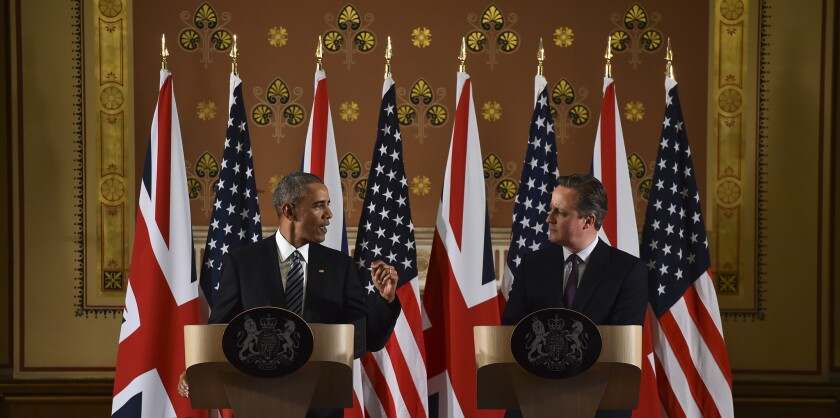 President Obama and British Prime Minister David Cameron hold a news conference Friday in London.